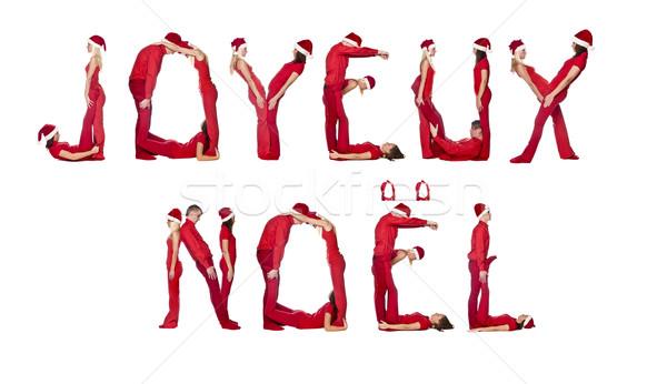 Elfs forming the phrase 'Joyeux Noel' Stock photo © gemenacom