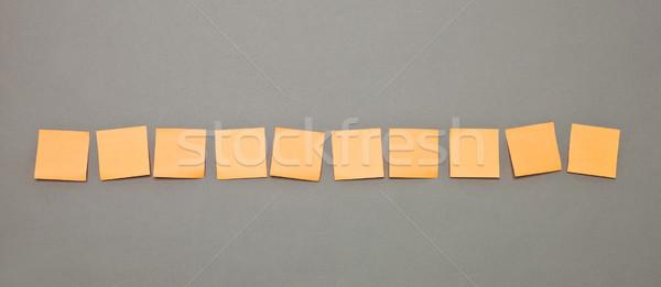 Zelfklevend merkt rij oranje communicatie billboard Stockfoto © gemenacom