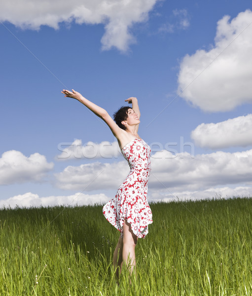 Young woman standing on a field Stock photo © gemenacom