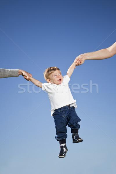 Gyermek levegő akasztás szülők kezek család Stock fotó © gemenacom