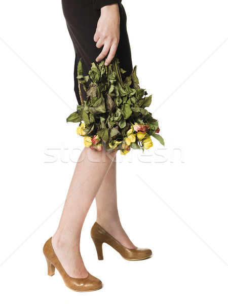 Woman holding a bunch of dead flowers Stock photo © gemenacom