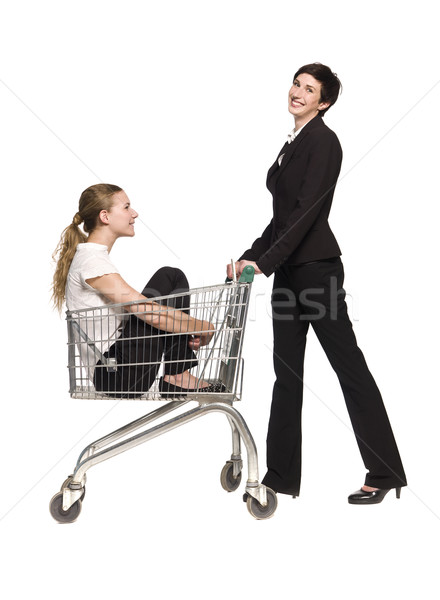 Woman with her friend in a shopping cart Stock photo © gemenacom