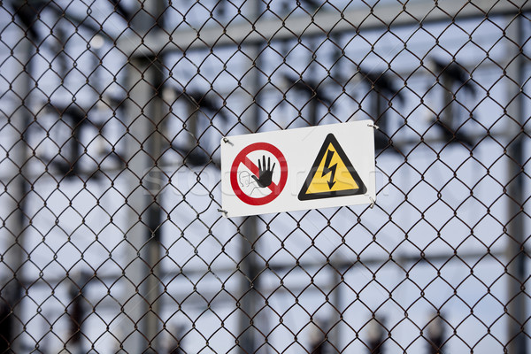 Warning signs on a fence with short focal depth. Stock photo © gemenacom