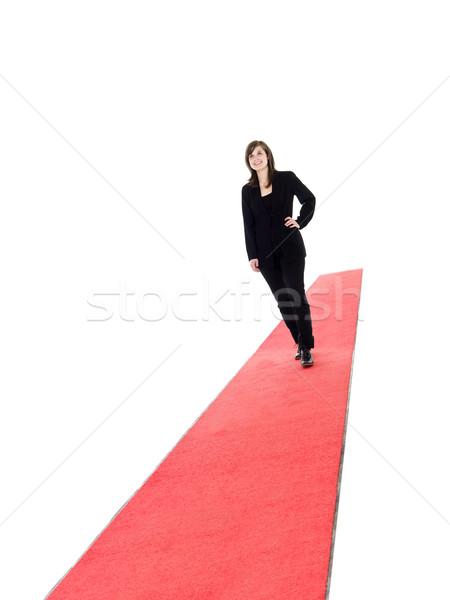 Glimlachend meisje lopen rode loper geïsoleerd witte Stockfoto © gemenacom