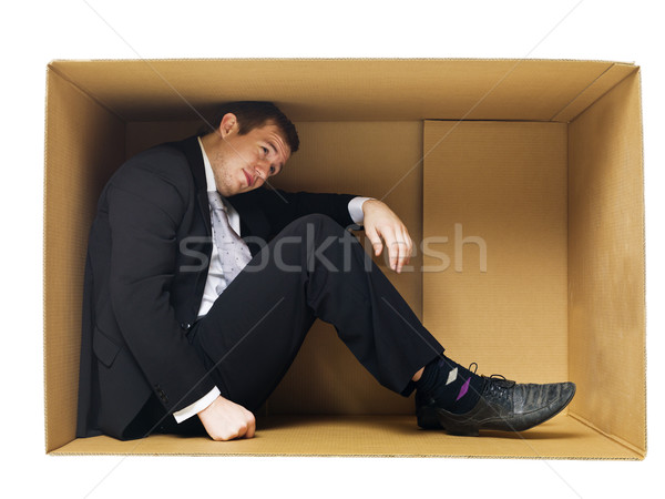 Businessman in a tight cardboard Stock photo © gemenacom
