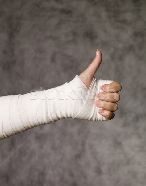 Person with bandage doing thumbs up Stock photo © gemenacom