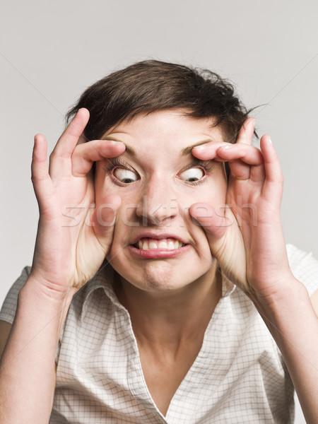 Portré nő készít vicces arc nők menedzser Stock fotó © gemenacom