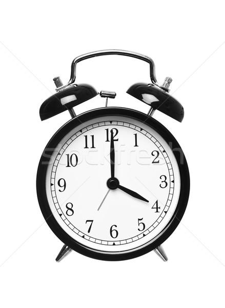 Alarm clock shows four o`clock Stock photo © gemenacom