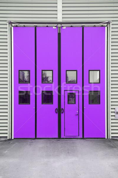 Purple Garage Door on a warehouse building Stock photo © gemenacom