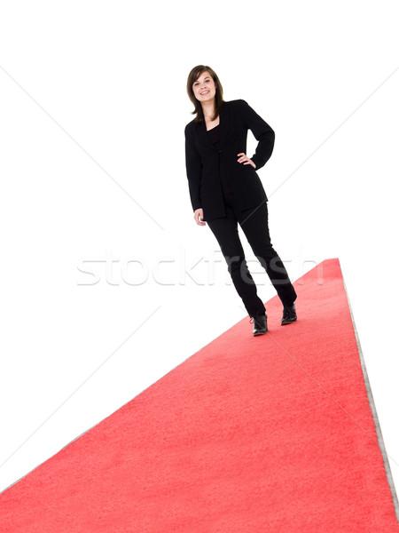 笑みを浮かべて 少女 徒歩 レッドカーペット 孤立した 白 ストックフォト © gemenacom