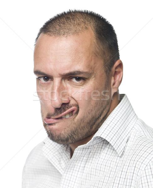 Portrait of a man making a funny face Stock photo © gemenacom
