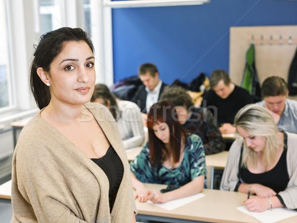 Teacher in classroom Stock photo © gemenacom