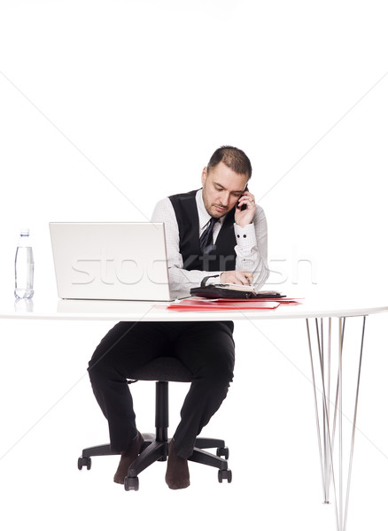 Man behind a desk organizing his day Stock photo © gemenacom