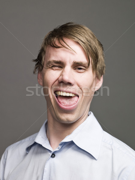 Portrait of a man making a funny face Stock photo © gemenacom