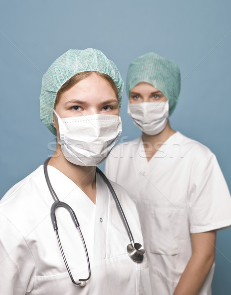 Stock photo: Two nurses with surgical masks and a stethoscope