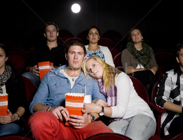 Fiatal pér mozi film színház eszik pattogatott kukorica Stock fotó © gemenacom
