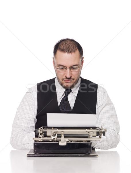 Man writing on a vintage typewriter Stock photo © gemenacom