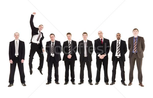 Saltando homem outro homens isolado Foto stock © gemenacom