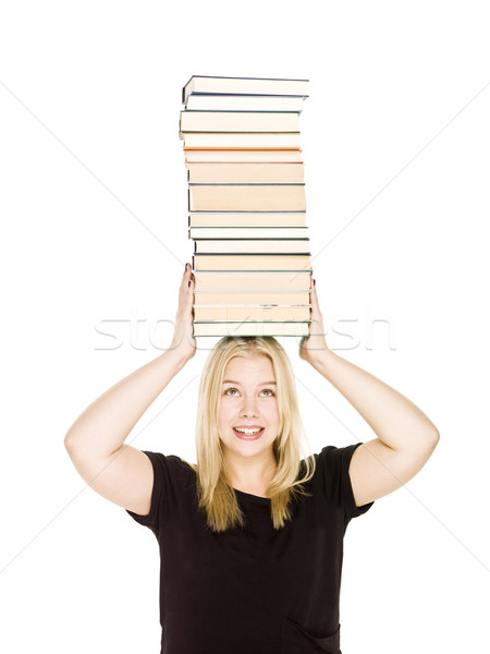 Woman with a pile of books on her head Stock photo © gemenacom
