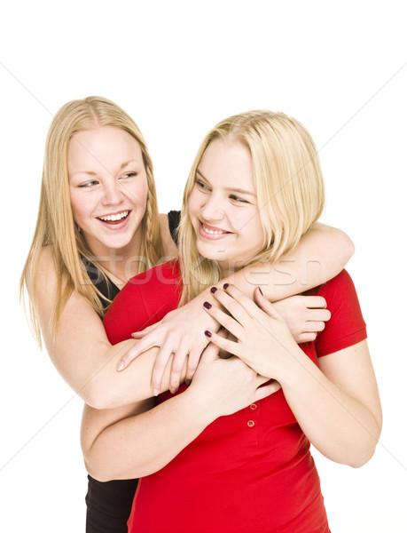 Bonding meisjes twee geïsoleerd witte liefde Stockfoto © gemenacom