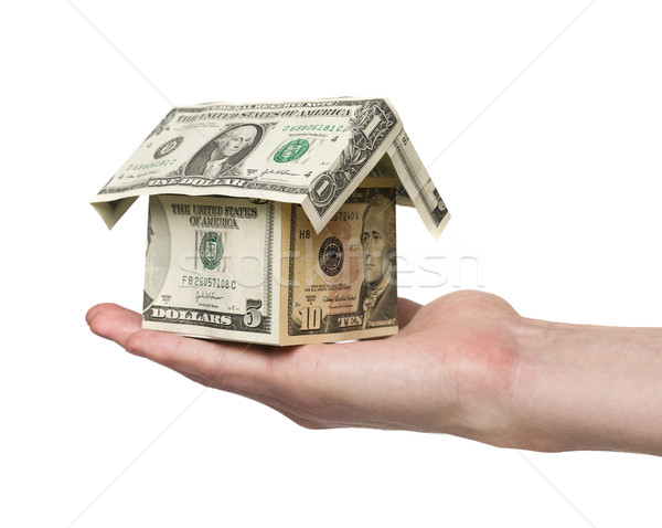 hand holding a small house built out of dollar bills Stock photo © gemenacom