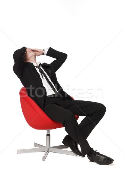 Man in red armchair Stock photo © gemenacom