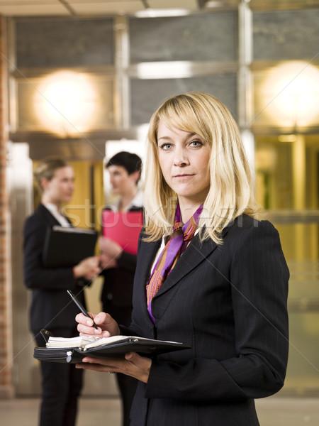 Mujer de negocios calendario negocios belleza traje Foto stock © gemenacom