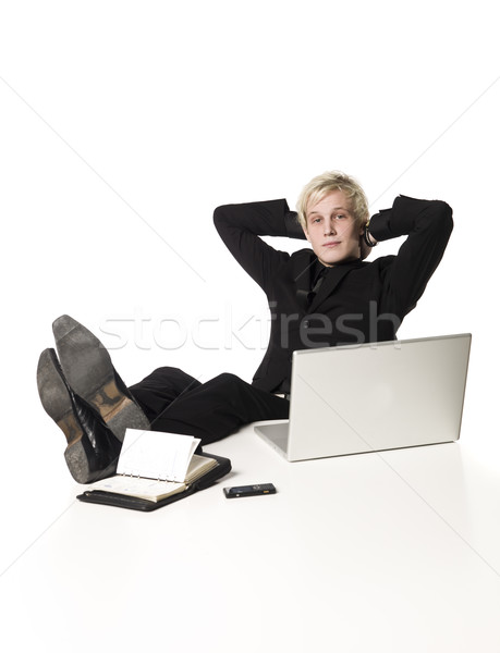 Relaxed boy infront of a desk Stock photo © gemenacom