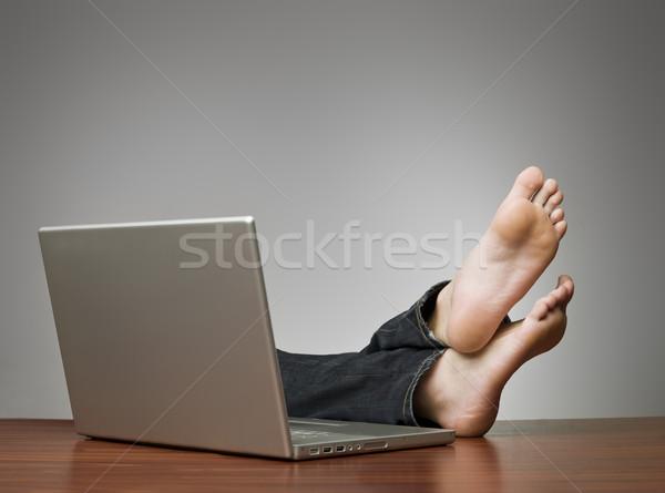 Pigro uomo ufficio computer business laptop Foto d'archivio © gemenacom