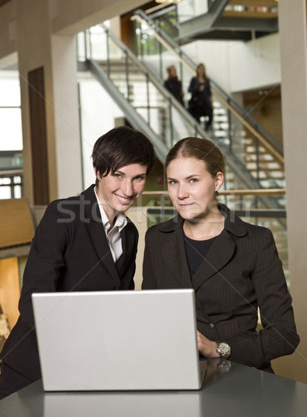 Two businesswomen in front of a laptop Stock photo © gemenacom