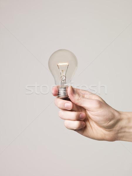 Hand holding shining light-bulb Stock photo © gemenacom
