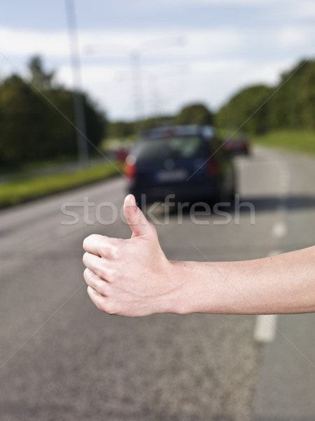A young man hitchiking on the road Stock photo © gemenacom