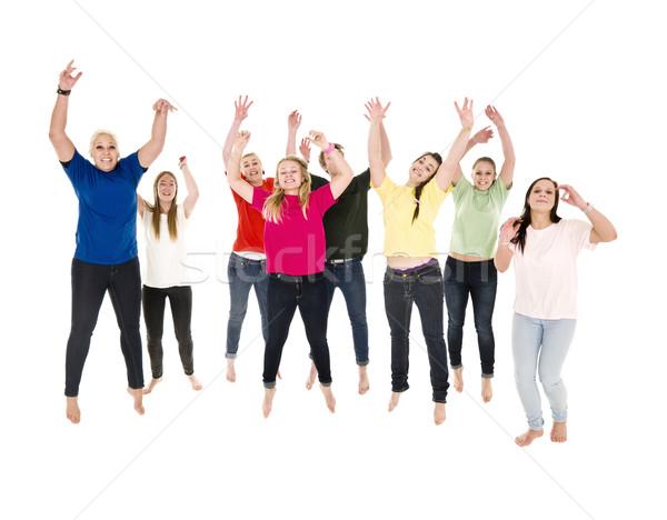 Skoki szczęśliwych ludzi biały kobiet zabawy zespołu Zdjęcia stock © gemenacom