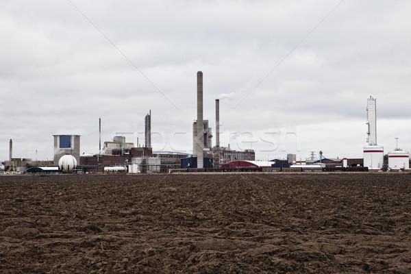 Industrial buildings behind a field  Stock photo © gemenacom
