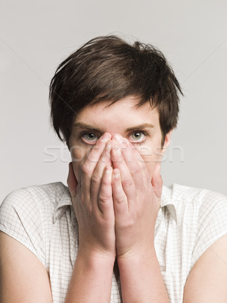 Portrait of an afraid woman Stock photo © gemenacom