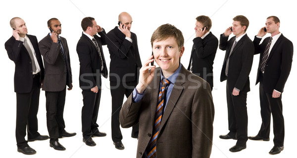 Man on the phone in front of his team Stock photo © gemenacom