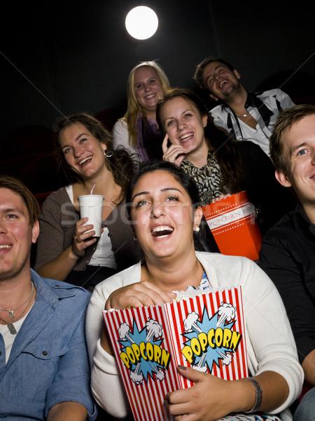 śmiechem kobieta kina worek popcorn Zdjęcia stock © gemenacom
