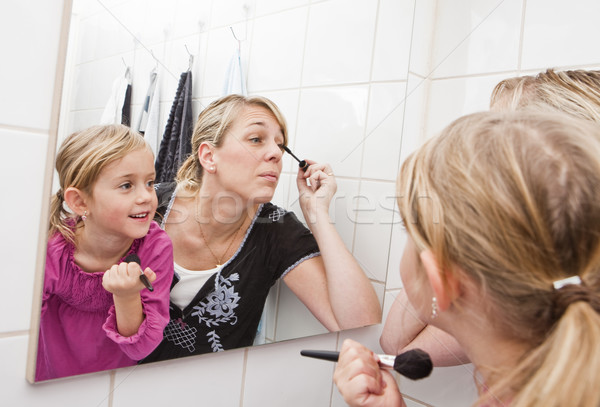 Mother and daughter put on make-up Stock photo © gemenacom