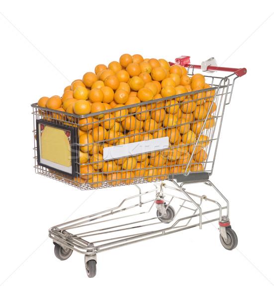 Bevásárlókocsi néhány narancsok üzlet gyümölcs fém Stock fotó © gemenacom