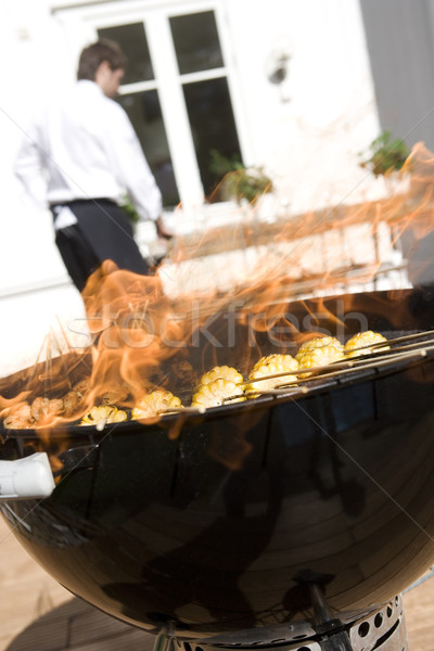 Outdoor barbecue with corn on the grill Stock photo © gemenacom