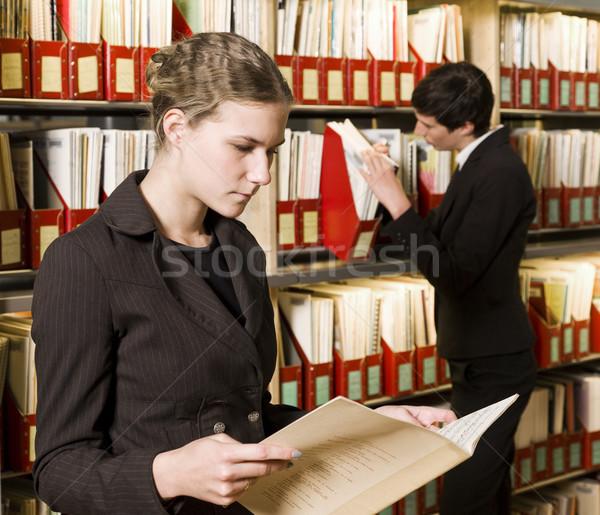 две женщины библиотека рабочих столе чтение обучения Сток-фото © gemenacom