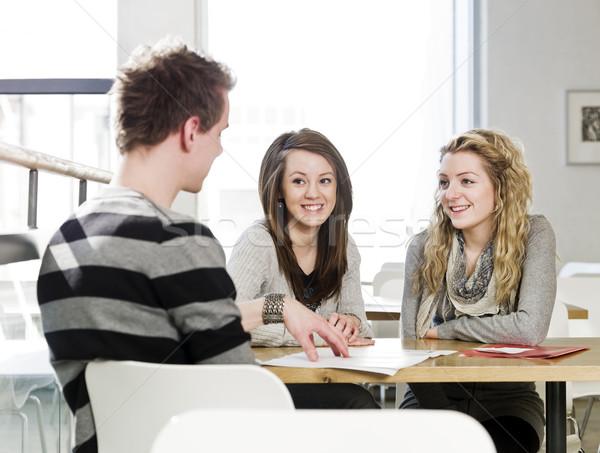two girls and a man talking Stock photo © gemenacom