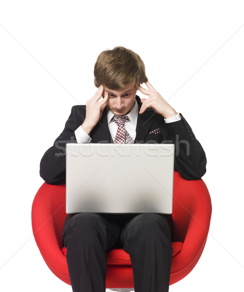 A depressed man with a laptop Stock photo © gemenacom