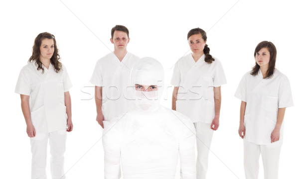 Patient in front of Healtcare Staff Stock photo © gemenacom