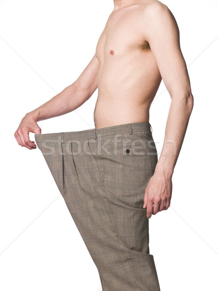 Man with oversized trousers towards white background Stock photo © gemenacom