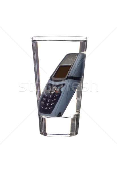 Komórkowych telefon szkła wody Zdjęcia stock © gemenacom