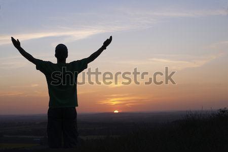 Homme coucher du soleil bras soleil paysage silhouette Photo stock © gemphoto