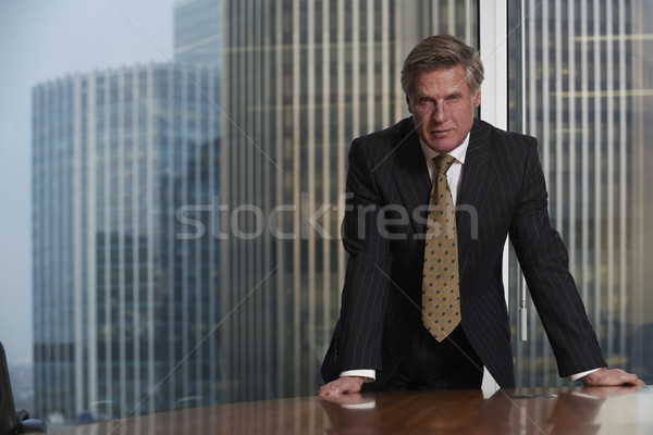 Homme d'affaires table boardroom regarder caméra Photo stock © gemphoto