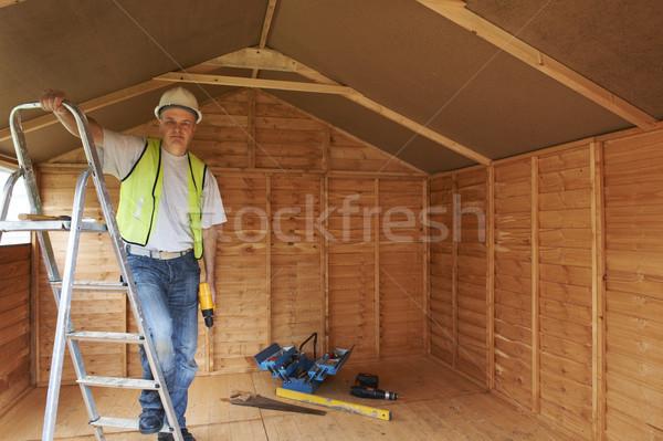 Constructeur portrait permanent échelle élevé Photo stock © gemphoto