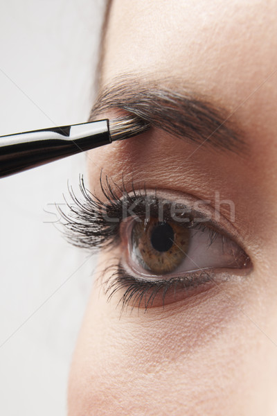 Yeux femme brosse blanche Photo stock © gemphoto